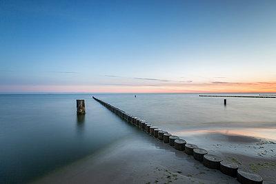 Groyne on Baltic Sea beach at dawn - p300m2220518 by Anke Scheibe
