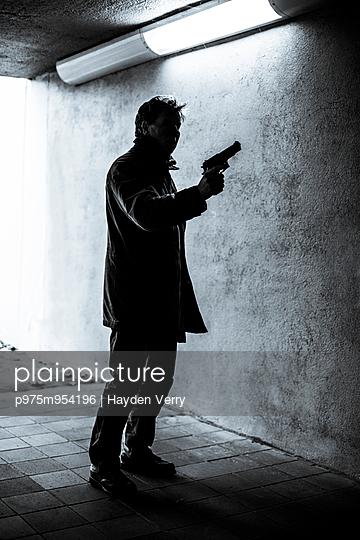 Man with Gun - p975m954196 by Hayden Verry