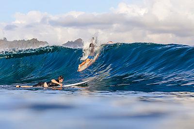 Two men surfing in sea - p343m2025647 by Konstantin Trubavin
