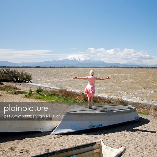 Woman on the beach - p1105m2168882 by Virginie Plauchut