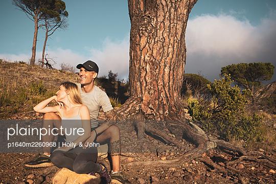 Sporty couple takes a break on hiking trip - p1640m2260968 by Holly & John