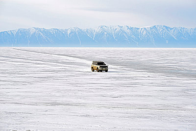 Russia, Lake Baikal, pickup truck driving on frozen lake - p300m1052874f by Gerald Nowak