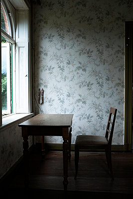 Cold room with chair and table - p5470028 by Liza Rothfuss