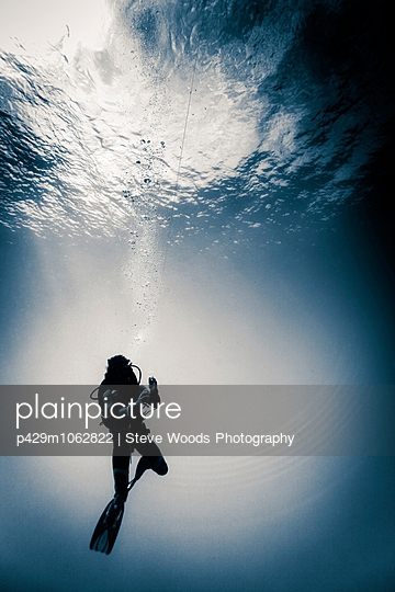 Scuba diver underwater doing a safety decompression stop, Lombok, Indonesia - p429m1062822 by Steve Woods Photography