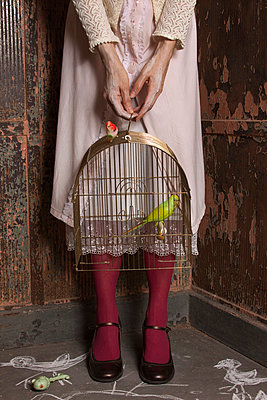 Woman with birdcage - p8370004 by Cornelia Hediger