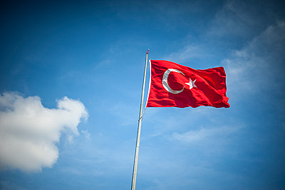 Turkish flag in blue sky - p1007m1134902 by Tilby Vattard