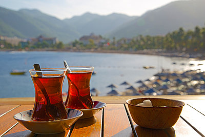 Turkish tea and beach, Icmeler, Marmaris, Anatolia, Turkey, Asia Minor, Eurasia - p871m998848f by Frank Fell