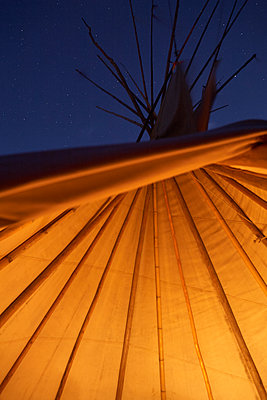 Inside of wigwam, bamboo stick structure - p1612m2223538 by Heidi Coppock-Beard