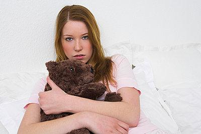 portrait of teenage girl holding teddy bear - p3162300f by Emana