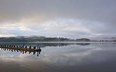 Pier stretching into still lake - p42918254 by Henn Photography