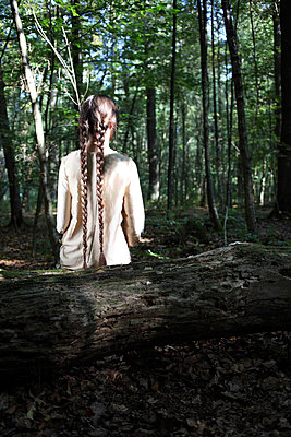 Woman with long braids - p045m953749 by Jasmin Sander