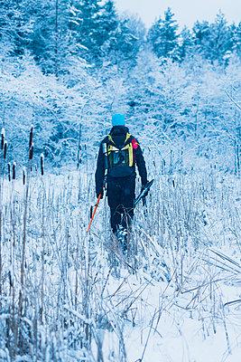 Man walking at winter - p312m1103674f by Hans Berggren
