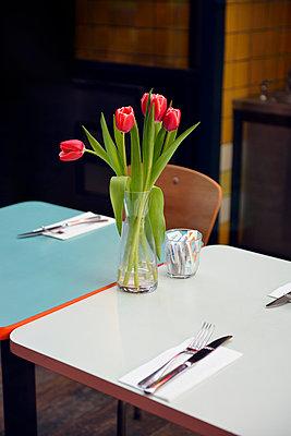 Tulips in a Bistro - p715m807995 by Marina Biederbick