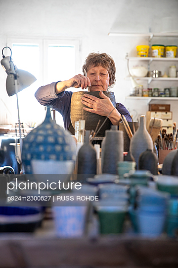 Spain, Baleares, Woman making ceramics in workshop - p924m2300827 by RUSS ROHDE