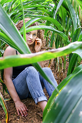 Teenage Girl in Cornfield - p1019m1475137 by Stephen Carroll