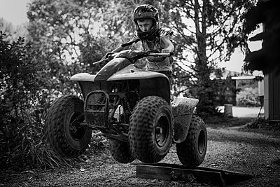 Boy on Four Wheeler - p1169m1463417 by Tytia Habing
