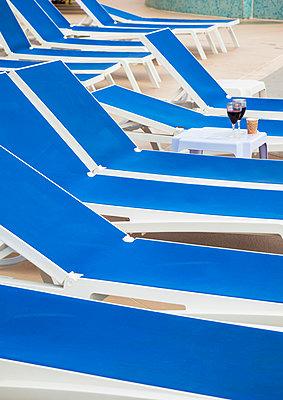 Sun loungers by the pool - p382m2134309 by Anna Matzen
