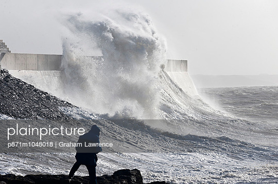 Waves crash against the harbour wall at Porthcawl, Bridgend, Wales, United Kingdom, Europe - p871m1048018 by Graham Lawrence