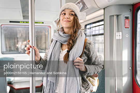 Portrait of young woman in a metro - p300m2155165 by Hernandez and Sorokina