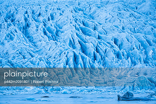 Glacier along the Southern shore of Iceland., icebergs are frozen into the lagoon at the base of it; Iceland - p442m2091801 by Robert Postma