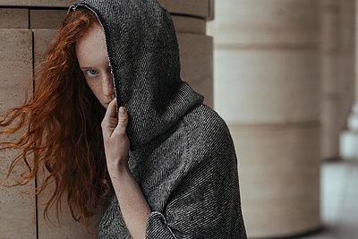 Caucasian woman hiding face behind hood - p555m1531626 by Ivan Ozerov