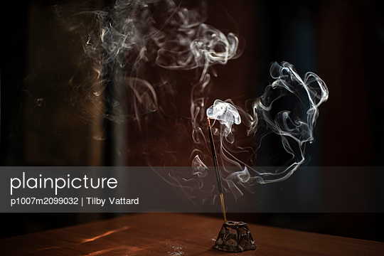 Incense stick burning - p1007m2099032 by Tilby Vattard