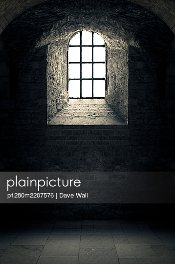 Historic arched castle window - p1280m2207576 by Dave Wall