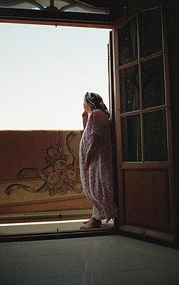 Musing old woman on balcony - p1118m1553116 by Tarik Yaici