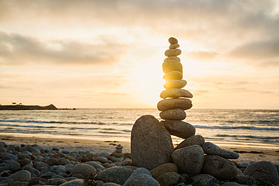 Stacked stones on beach at sunset - p1427m2146619 by Erik Isakson