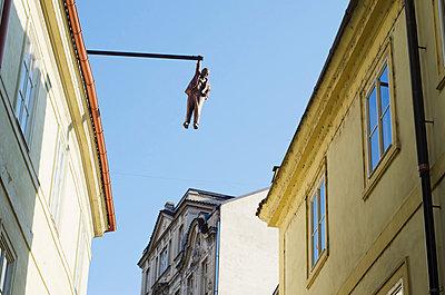 Hanging man above the street by David Cerny, Prague, Czech Republic, Europe - p871m805575 by Christian Kober