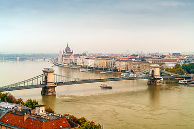 View of Széchenyi Chain Bridge and the Parliament in background at dawn - p1332m1502316 by Tamboly