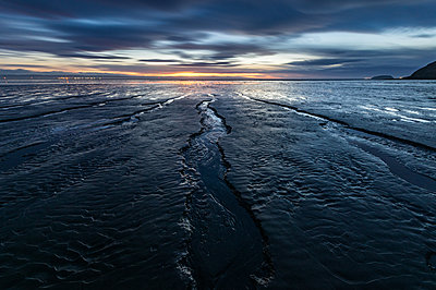 Brean Beach, mud and the Bristol Channel at sunset, Somerset, England, United Kingdom - p871m2113633 by Bill Ward