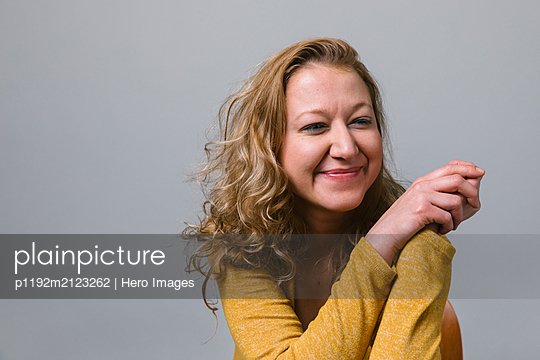 Portrait smiling, carefree woman - p1192m2123262 by Hero Images