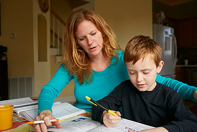 Caucasian mother helping son do homework - p555m1413164 by Jeff Greenough