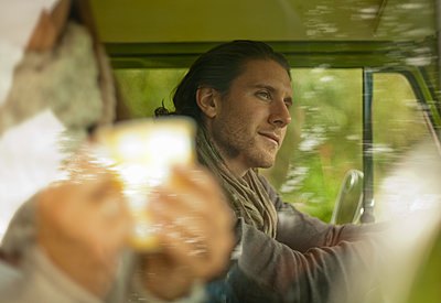 Contemplated man in camper van looking away - p300m2250213 by LOUIS CHRISTIAN