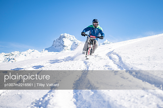 France, Man riding skibike - p1007m2216561 by Tilby Vattard
