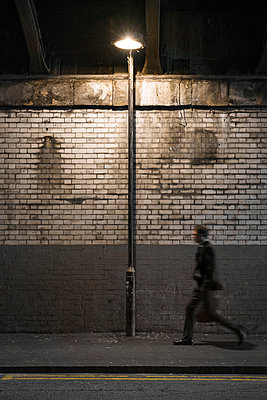 man walking under railway bridge - p1280m2008556 by Dave Wall