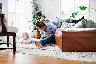Mother playing with baby boy - p312m2052671 by Anna Johnsson