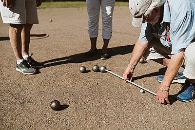People playing petanque - p312m2146311 by Stina Gränfors