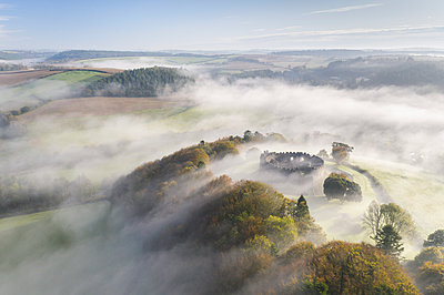 Aerial view by drone of autumn mist swirling above Restormel Castle in Cornwall, United Kingdom, Europe - p871m2209422 by Adam Burton