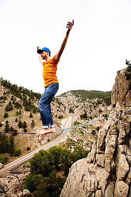 A male highliner walks the Elephant Buttresses highline in Boulder Canyon - p343m801178f by Kyle Sparks