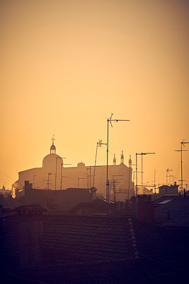 Antennas and church in the sunrise - p1312m2082217 by Axel Killian