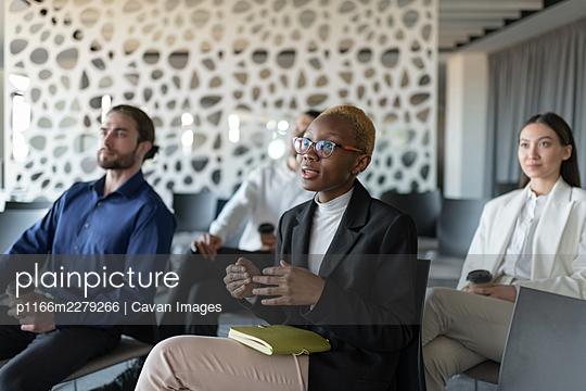 Black businesswoman speaking during seminar - p1166m2279266 by Cavan Images