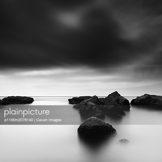 Long exposure of sea rocks and dramatic sky in Inamuragasaki, Kanagawa - p1166m2078140 by Cavan Images