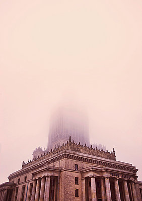 A building with a tower in fog. - p312m696057 by Bruno Ehrs