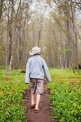 Boy walking alongåÊPictured Rocks National Lakeshore trail - p343m1446691 by Steve Glass