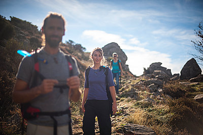 Three people walking in nature - p1007m1144442 by Tilby Vattard