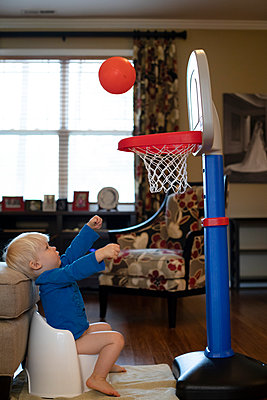 Portrait of a young boy playing basketball while potty training - p1480m2148167 by Brian W. Downs