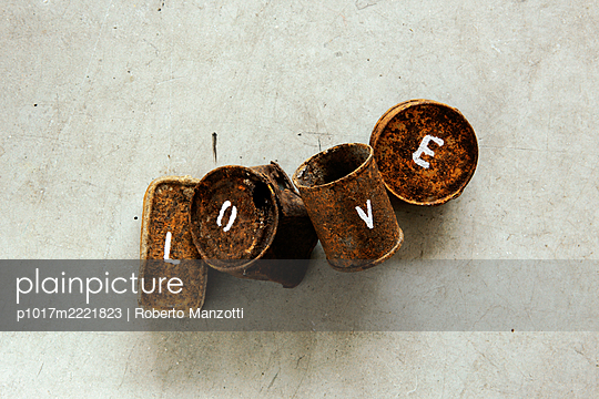 Tin cans with letters, love - p1017m2221823 by Roberto Manzotti