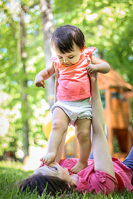 Mother and Daughter play in yard  - p1019m1425955 by Stephen Carroll